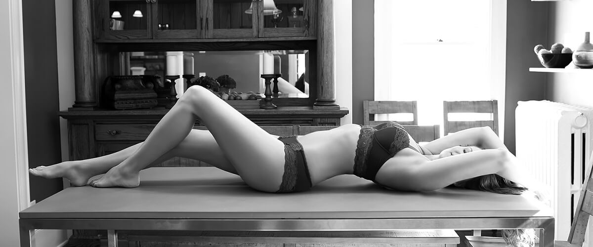 Erin Lee laying on a table wearing bra and panties, in Minneapolis, MN